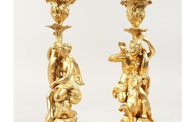 A GOOD PAIR OF GILT BRONZE CLASSICAL CANDLESTICKS on scrolle...