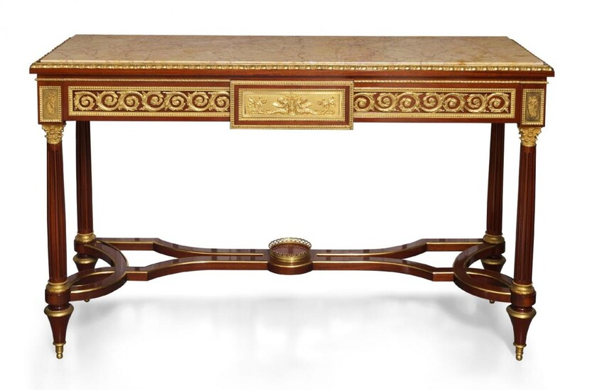 A Louis XVI style mahogany and ormolu mounted console table, second half 20th century, the rectangular top with yellow and red variegated marble, above frieze with scrolling foliate ormolu mounts flanking central panel decorated with putti and...
