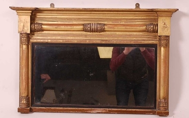 A Victorian giltwood and gesso chimney mirror, having acanthus...