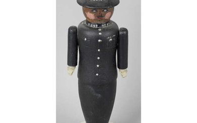 A carved and painted wooden folk art lamp base modelled as a police officer.