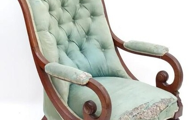 A mid / late 19thC mahogany armchair with a shaped deep