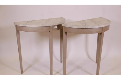 A pair of antique demilune console tables with later painted...