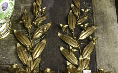 A pair of gilt patinated tole leaf form wall sconces