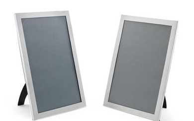 A pair of large Edwardian silver photograph frames