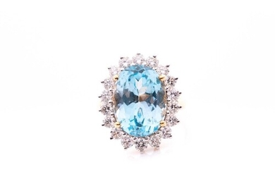 An 18ct yellow gold, diamond, and blue topaz cocktail ring, ...