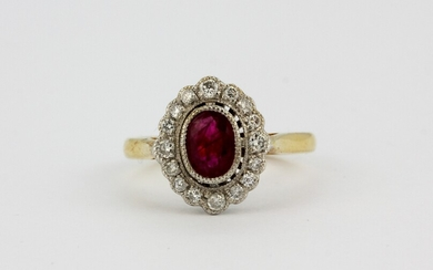 An 18ct yellow gold ruby and diamond set cluster ring, (N.5).