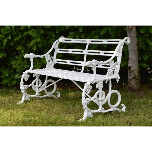 Cast iron garden bench in the Coalbrookdale style with grape...