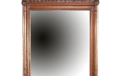 (-), Faceted mirror in oak richly decorated frame...