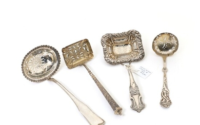 """Four various silver sugar strainers, a.o. """"Gammelriflet"""", """"Tang"""" and a Norwegian (Bergen) Rococo revival strainer...."""