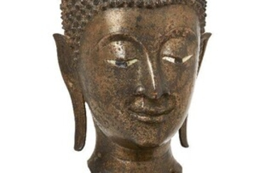 Property of a Gentleman (lots 36-85) A large bronze head of Buddha Shakyamuni, 17th/18th century, cast with serene expression and downcast eyes, with elongated earlobes, 24cm high, metal stand