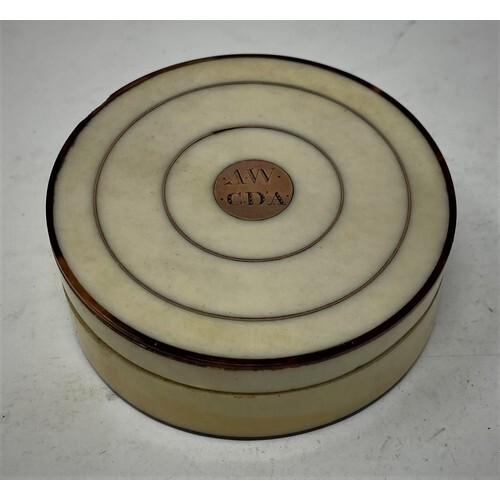 A 19th century tortoiseshell and ivory circular box and cove...