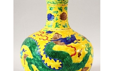 A CHINESE MING STYLE YELLOW GROUND FAHUA VASE, decorated wit...
