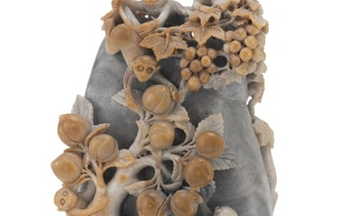 A CHINESE SOAPSTONE GROUP DEPICTING A ROCK WITH MONKEYS. 20TH CENTURY.
