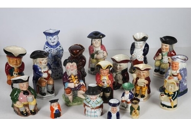 A COLLECTION OF NINTEEN TOBY JUGS to include a wood potters ...
