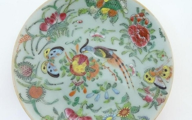 A Chinese celadon style plate decorated with bird