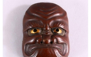 A JAPANESE MEIJI PERIOD BRONZE NOH MASK, with gilt eye decor...