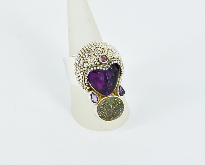A MULTI GEMSTONE AND SILVER RING