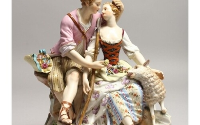 A SUPERB 19TH CENTURY MEISSEN FIGURE OF LOVERS seated on a r...