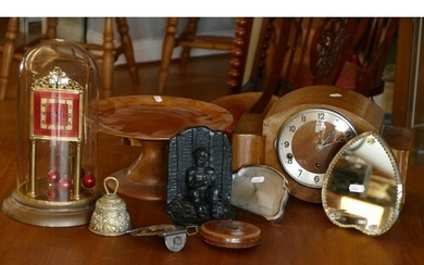 A manual wind anniversary clock under glass dome, together w...