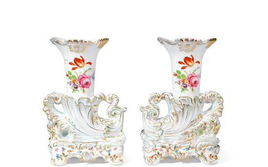 A pair of Continental porcelain rhyton shaped garniture vases