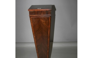 Edwardian walnut pedestal of tapering form, with lift top op...