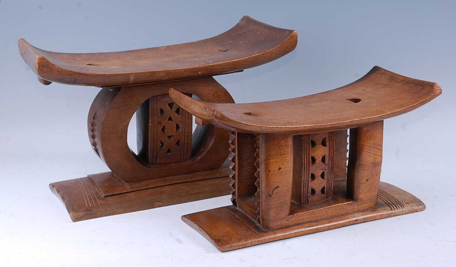 Lot details An Asante carved hardwood stool, the shaped...