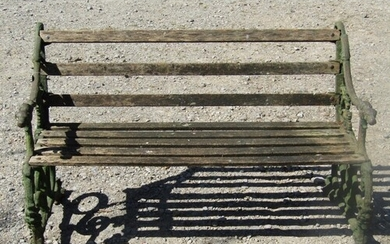 Old cast iron timber and garden bench, the ends with hound a...