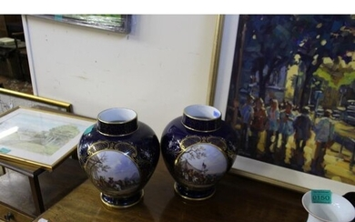 Pair of Blue Porcelain Vases with Oval decorated Panels (sma...