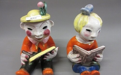 Pair of walter Bosse glazed terracotta figures of seated chi...