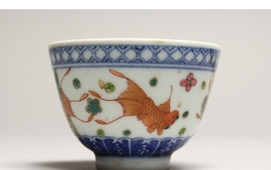 A CHINESE PORCELAIN TEA BOWL decorated with fish. Signed, ma...