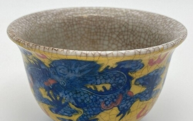 A Chinese crackle glaze ceramic tea bowl. Yellow ground with...