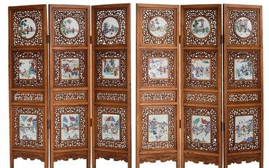 A Chinese openwork carved exotic hardwood six-panel screen, the circular...