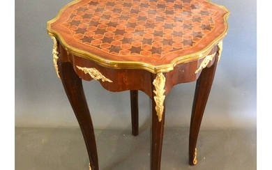 A French inlaid and gilt metal mounted lamp table, the star ...