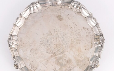 A GEORGE II SILVER SALVER having a raised moulded shell bord...