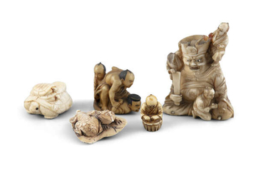 A JAPANESE CARVED IVORY GROUP, depicting three men...