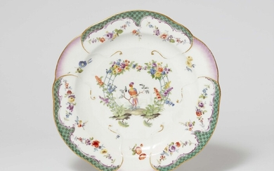 A Meissen porcelain plate from a dinner service with a green mosaic border