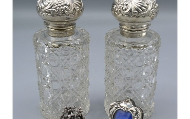 A Pair of Silver Topped Cut Glass Scent Bottles, 13.5 cms ta...