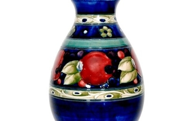 A William Moorcroft Banded Pomegranate pattern vase of ovoid...