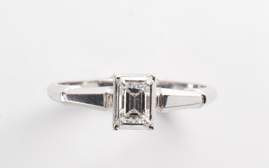 A diamond and eighteen karat white gold ring