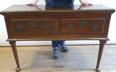 A fruitwood dresser, having two frieze drawers, on turned le...