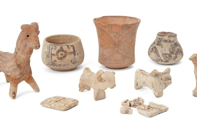 A group of Proto-Indus valley animal figures, comprising a three slip-painted vessels, a model of a ram, two sheep, a bird, and two rectangular carved bone buttons (one fragmentary), ram 9.7cm. high (9) Provenance: Private London Collection formed...