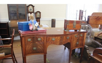 A reproduction mahogany serpentine serving table, of Adam st...