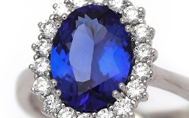 NOT SOLD. A tanzanite and diamond ring set with a tanzanite weighing app. 2.45 ct. encircled by numerous diamonds, mounted in 18k white gold. Size app. 53.5. – Bruun Rasmussen Auctioneers of Fine Art