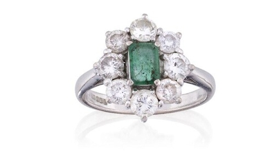 An 18ct gold, emerald and diamond cluster ring, the rectangular-cut emerald in four claw 18ct white gold mount, Sheffield hallmarks, surrounded by eight brilliant-cut diamonds, ring size P