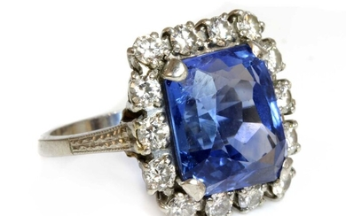 An American sapphire and diamond cushion-shaped cluster ring