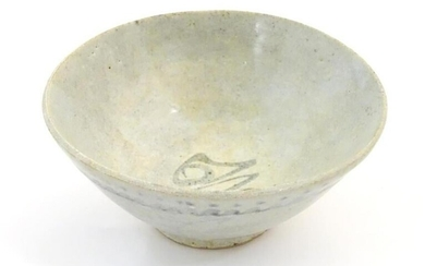 An Oriental earthenware bowl of tapering form with