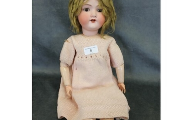 An early 20th century German bisque head doll, mould no.390,...