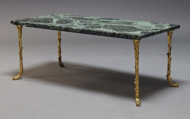 Attributed to Maison Bagués, a marble top and brass coffee...