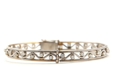 Diamond bangle set with numerous brilliant-cut diamonds totalling app. 1.00 ct., mounted in 14k white...