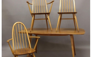 ERCOL DINING TABLE & FOUR CHAIRS a light elm dining table wi...